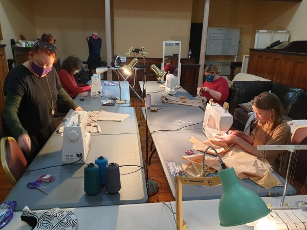 group of students using sewing machines