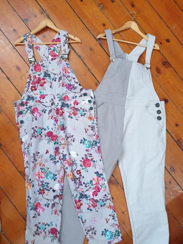 two pairs of overalls one floral, one grey and white