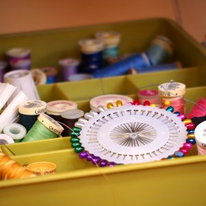 pins and thread in a sewing box